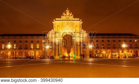 The Rua Augusta Arch At The Praca Do Comercio At Sunset. The Arch Is A Famous Tourist Attraction In