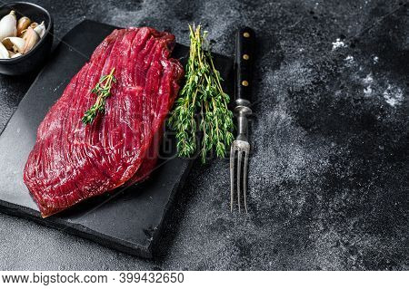 Venison Raw Steak From Wild Meat. Black Background. Top View. Copy Space