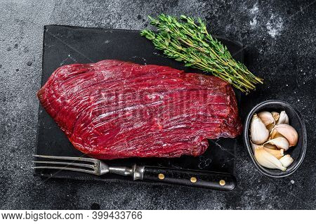 Venison Raw Steak From Wild Meat. Black Background. Top View