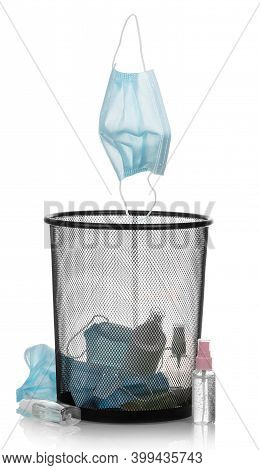 Garbage Bin With Used Personal Protective Equipment, Masks, Sanitizers Isolated On White Background