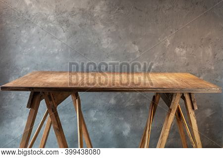 wooden table or tabletop near concrete wall background, place for work tools