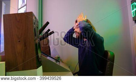 Man In Old Recording Studio. Media. Young Man Wearing Headphones Speaks Into Recording Microphones.