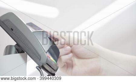 Pos Terminal, Payment Machine With A Credit Card In A Mans Hand On A Light Background In A Supermark