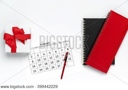 Valentines Day Template, Top View Of Calendar With Pen, Gift Box, And Notepad On White Background, M