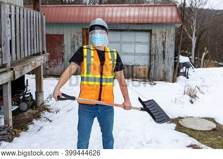 Medium Full Shot Of A Man Wearing A Fluo Visibility Jacket Over A T-shirt, Protective Face Mask And