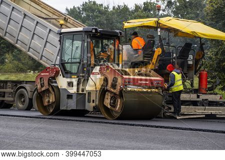 Kyiv, Ukraine - September 25, 2020:: Heavy Asphalt Road Roller With Heavy Vibration Roller Compactor