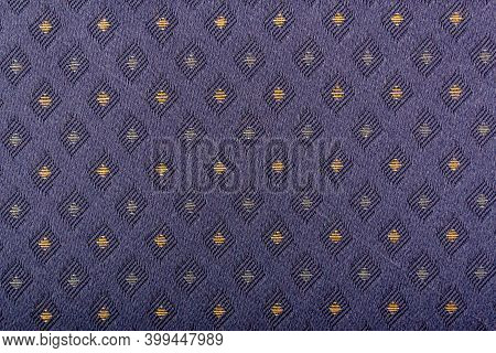 Purple Fabric With Yellow Lozenges As The Background Texture. Close-up Long And Wide Texture Of Natu