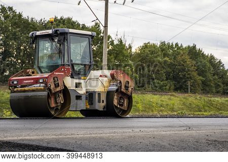 Kyiv, Ukraine - September 25, 2020: Heavy Yellow Asphalt Road Roller With Heavy Vibration Roller Com