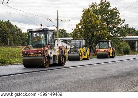 Kyiv, Ukraine - September 25, 2020: Three Heavy Asphalt Road Roller With Heavy Vibration Roller Comp