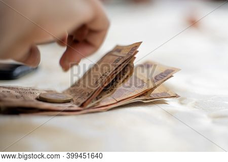 Indian Currency Rupee Notes And Coins Placed On Table Showing Payments, Money, Saving And Gambling I