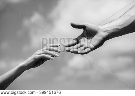 Solidarity, Compassion, And Charity, Rescue. Hands Of Man And Woman Reaching To Each Other, Support.