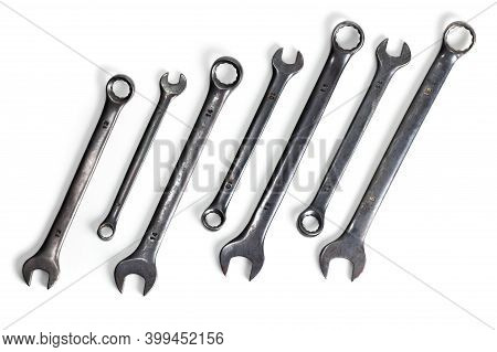 Spanner Set Isolated. Dark Coloured Spanners Lying Side By Side In White Background