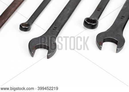Spanner Set Isolated. Dark Coloured Spanners On White Background