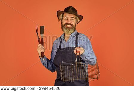 Spring Season. Bearded Hipster Wear Hat And Apron For Barbecue. Roasting Meat. Picnic And Barbecue.