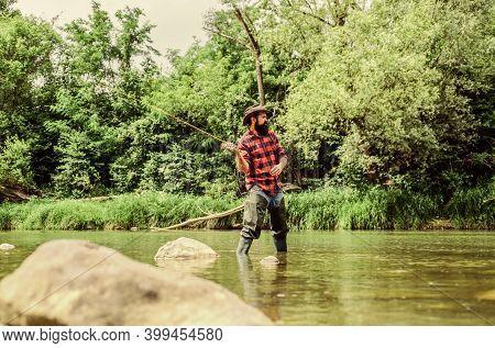 Man Bearded Fisherman. Fisherman Fishing Equipment. Hobby Sport Activity. Fish Farming Pisciculture