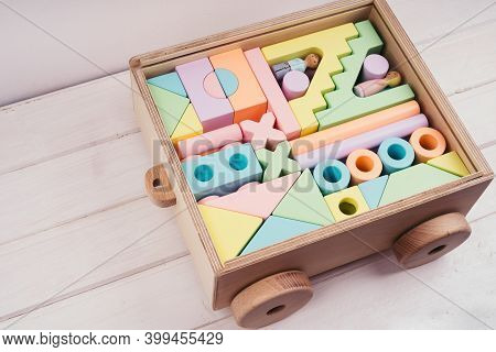 Childrens Toys Made Of Natural Material. Wooden Construction Kit In A Large Box-cars Made Of Plywood
