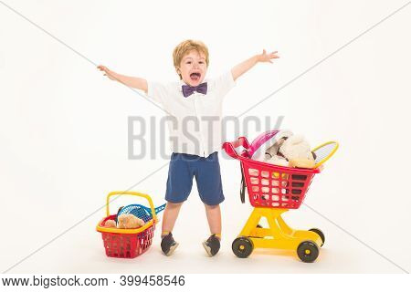 Shopping, Discount, Sale Concept. Happy Little Boy With Shopping Cart And Basket. Kid Plays In Shop.