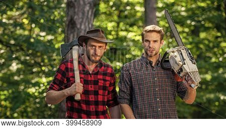 Enjoying Summer. Ranger Or Poach. Man Forester Use Saw And Axe. Search Firewood For Picnic Campfire.