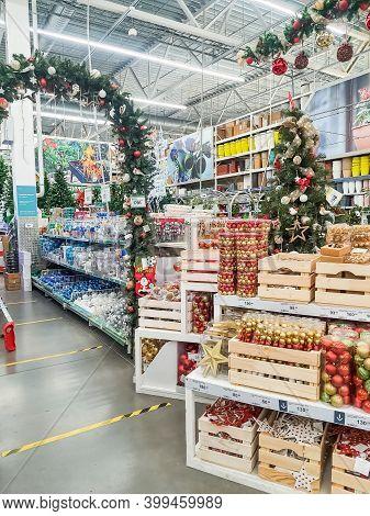 Omsk, Russia, 1 November 2020: Christmas Shopping. Festive Decor. Christmas Balls Sets Of Toys On Th