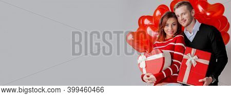 Couple with heart shaped balloons and gifts, Valentines day concept