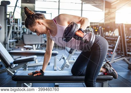 Young Sporty Woman Training In The Gym
