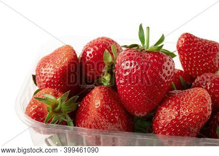 Strawberries Front-view Isolated On White Background. Heart Shape Strawberry In Plastic Basket Conta
