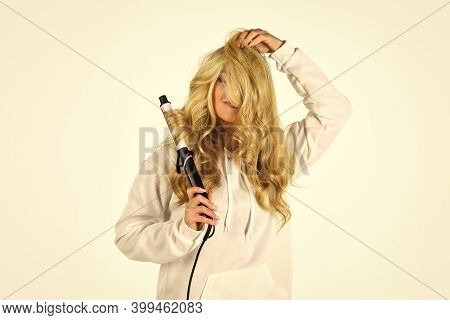 Woman With Long Curly Hair Use Curling Iron. Hairdresser Equipment. Ceramic Coating That Minimizes H