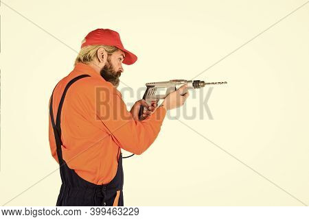 For Drilling Solid Wall You Need Masonry Bit. Man In Cap With Drills White Background. Builder Repai