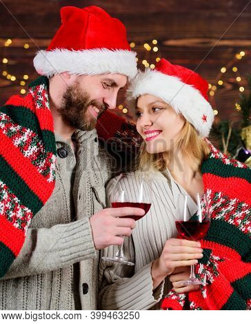 Couple In Love Enjoy Red Wine. Idyllic Date. Man Woman Santa Claus Hats Cheerful Celebrating New Yea