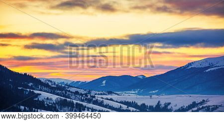 Winter Landscape In Mountains At Sunrise. Beautiful Rural Area Of Carpathian Mountains With Snow Cov