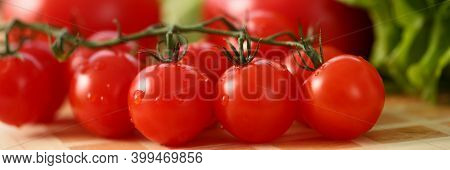 Close Up Of Wood Desk With Fresh Delicious Tomatoes With Dewdrops