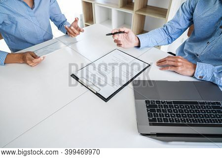 Interviewer Or Board Reading A Resume During Job Interview, Employer Interviewing A Young Male Job S