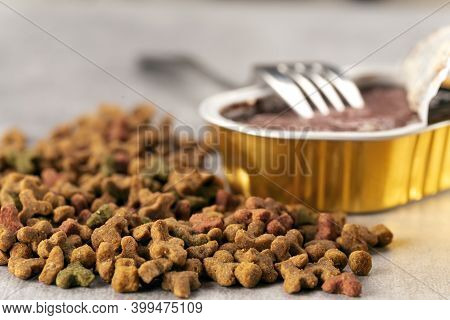 Wet And Dry Pet Food. Cat Or Dog Pate On Old Table. Top View