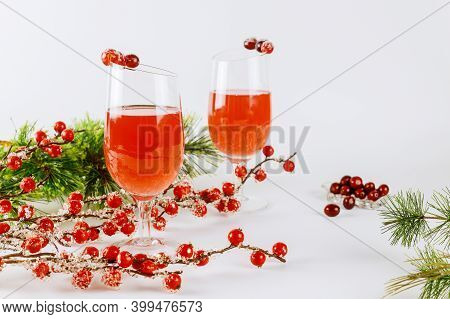 Two Cranberry Cocktails With Fresh Cranberry On White Background.