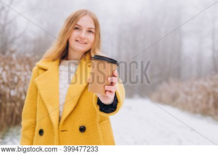 Happy Young Woman Holds Paper Coffee Cup Over Nature Background, Trendy Color Of Year 2021 - Illumin