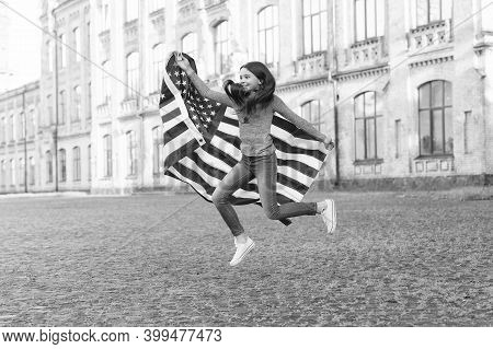 Choose Independence. Happy Child Celebrate Independence Day. Energetic Girl Jump With American Flag.