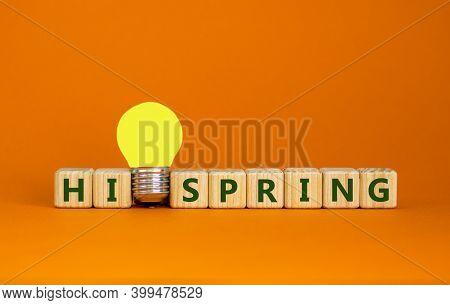 Hi Spring Symbol. Wooden Cubes With Words 'hi Spring'. Yellow Light Bulb. Beautiful Orange Backgroun