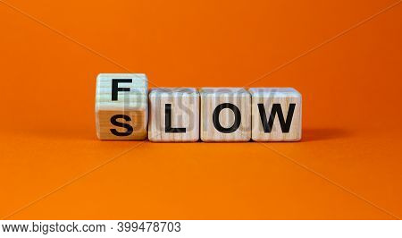 Be Slow Or In The Flow. Turned A Cube And Changed The Word 'slow' To 'flow'. Beautiful Orange Backgr