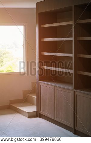 Side View Of Empty Wooden Cabinet Inside Of Living Room In Incomplete House Building Site In Vertica