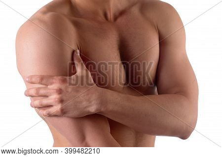 Muscular Strong Man With Shoulder Pain, Isolated On White Background. Sportsman Holds His Sore Shoul