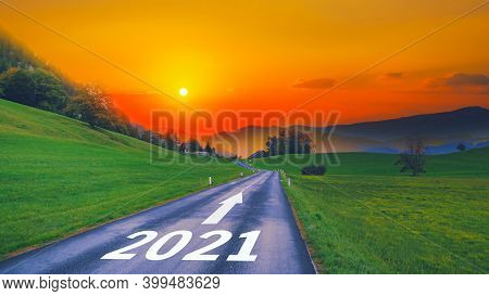 Empty Open Asphalt Road And New Year 2021 Concept. Driving On Empty Road Goals Against Sun In Mounta