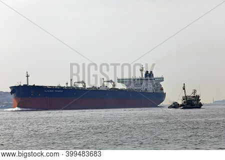 Istanbul, Turkey - October 06, 2020. Huge Crude Oil Tanker And Small Vessel Sailing In The Bosphorus