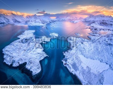 Aerial View Of Lofoten Islands In Winter At Sunset In Norway. Landscape With Blue Sea, Snowy Mountai
