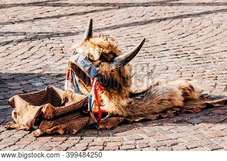Headdress In American Style With Horns. Part Of Traditional Costume Lying On The Ground With Box For