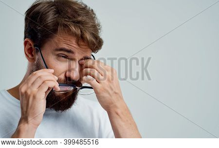 Man With Glasses In Hand On A Gray Background Vision Problems Eye Pain Diopter