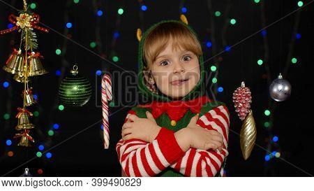 Little Fun Blonde Kid Teen Teenager Girl In Christmas Elf Santa Helper Costume Hugging, Embracing, S