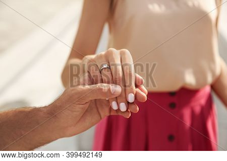 Lovely Couple With Beautiful Ring After Engagement Outdoors, Closeup