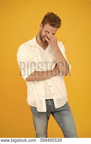 Horrible Headache. Handsome Man In Jeans Shirt Suffering Head Pain. Tired And Stressful Man Yellow B