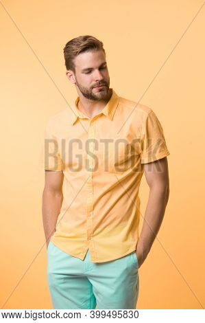 Casual Style. Man On Calm Face Posing Confidently Put Hands Pockets. Man Attractive In Casual Shirt.