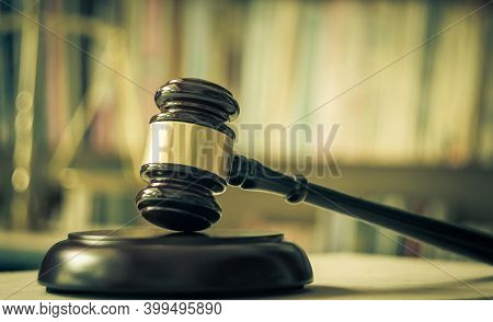 Legislation Concept: Judge Gavel With Scales On Library